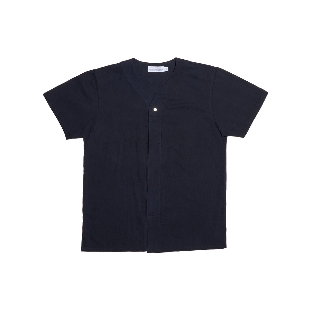 Post-Imperial Adire solid dyed black baseball shirt. Dyed in Nigeria, Made in USA