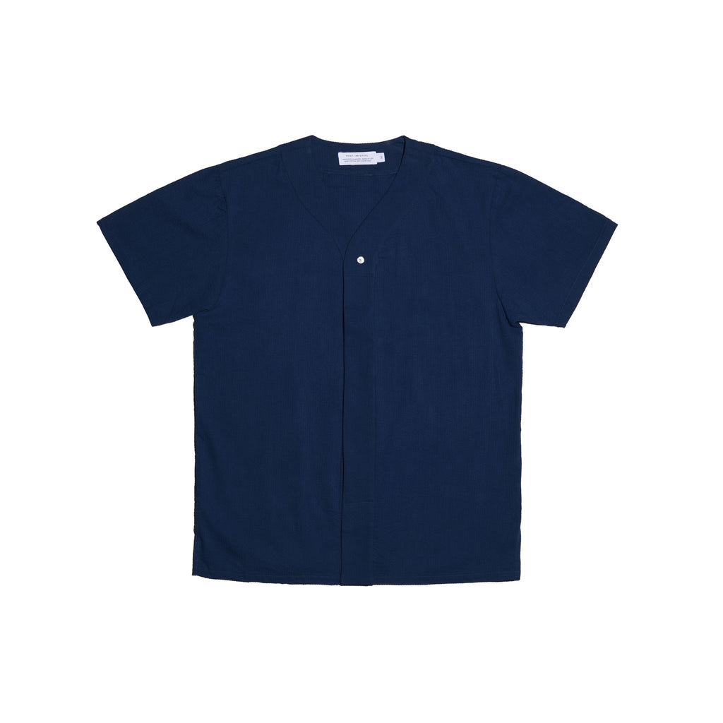 Post-Imperial Adire solid dyed indigo baseball shirt. Dyed in Nigeria, Made in USA