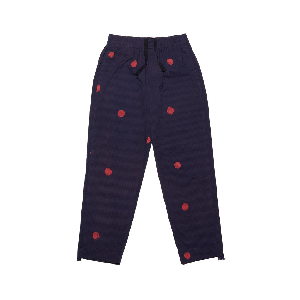Post-Imperial Lagos Seersucker Pants with with Adire Indigo-Red Dyed Megadot Pattern. Dyed in Nigeria, Made in USA