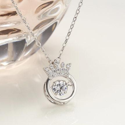 Crown beating heart necklace