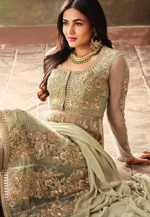 Light Green Net Embroidered Kurta And Pant Suit