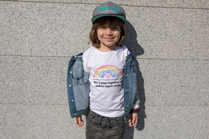 Boy wearing personalised Minimello Rainbow tshirt featuring names of children in his school class in support of the charity NHS Charities Together