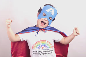 Boy wearing personalised Minimello Rainbow tshirt featuring nursery and school children names in support of the charity NHS Charities Together