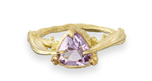 18 carat yellow gold engagement ring with a hand faceted amethyst gemstone. The ring has been cast from a twig and also crab claws with lots of texture and detail in a contemporary style. Made by Irish jeweller Eily O Connell from Donegal in Ireland.