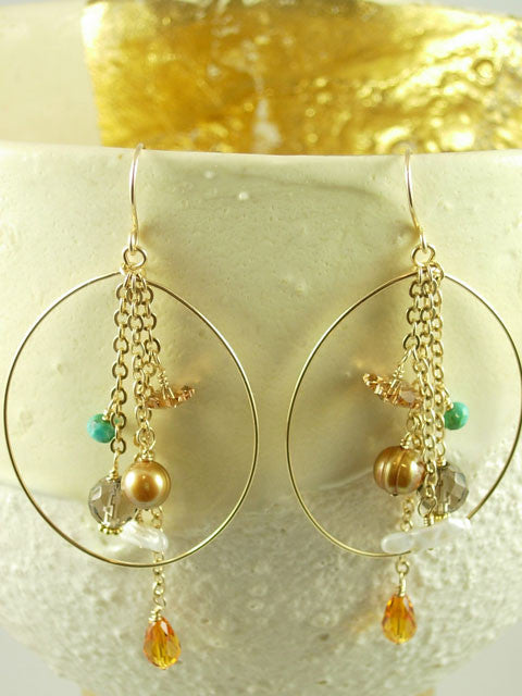 Oval hoops with chains and bead earrings