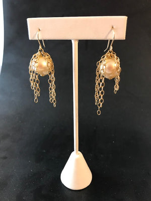 Pearl and cascade of chain earrings