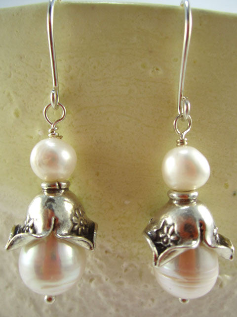 E233 Two white pearls with fancy bead cap earrings