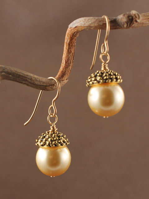 Pearl with dotted bronze cap earrings