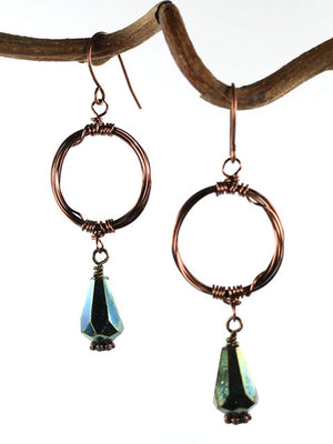 Wire wrapped copper circle green crystal earrings