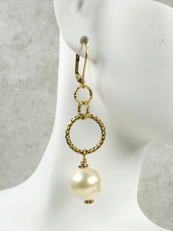 Twisted gold hoops and pearl earrings