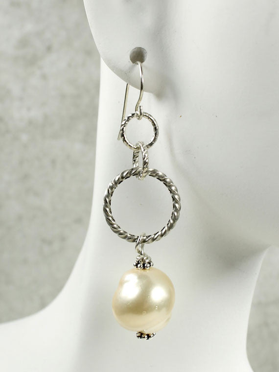 Twisted silver hoops and pearl earrings