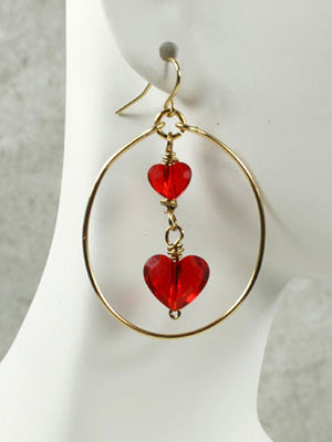 Hoops with red crystal hearts earrings