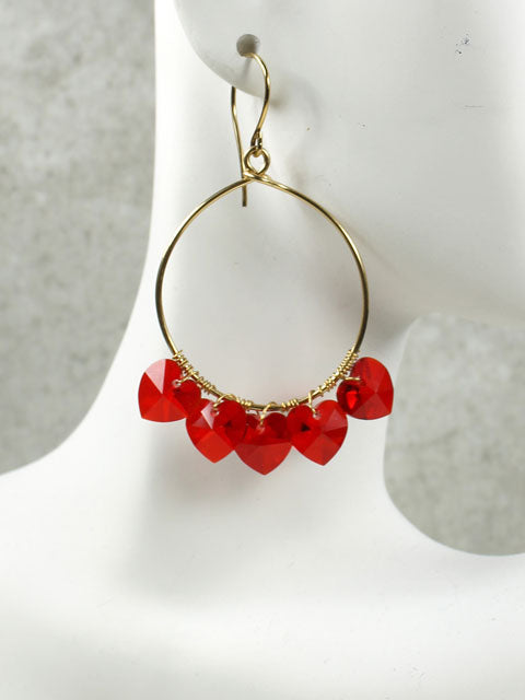 Hoops with five red crystal hearts earrings