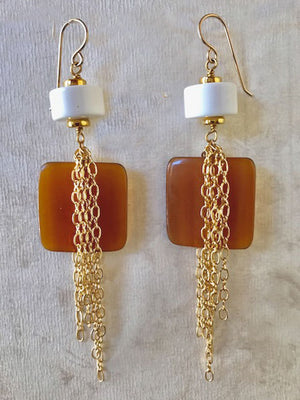 White lucite and chained horn earrings