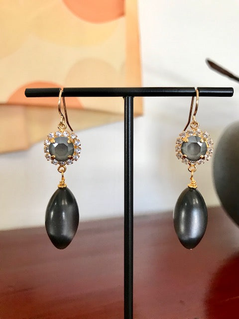 Gray crystal and lucite dangle earrings