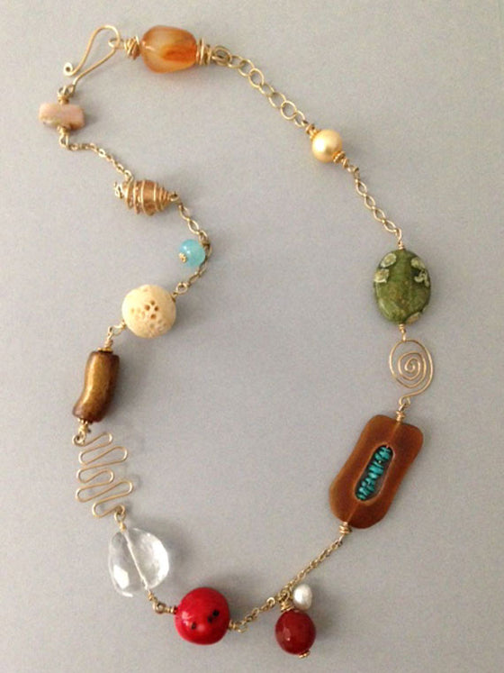 Multi gemstone beads with gold wire shapes necklace