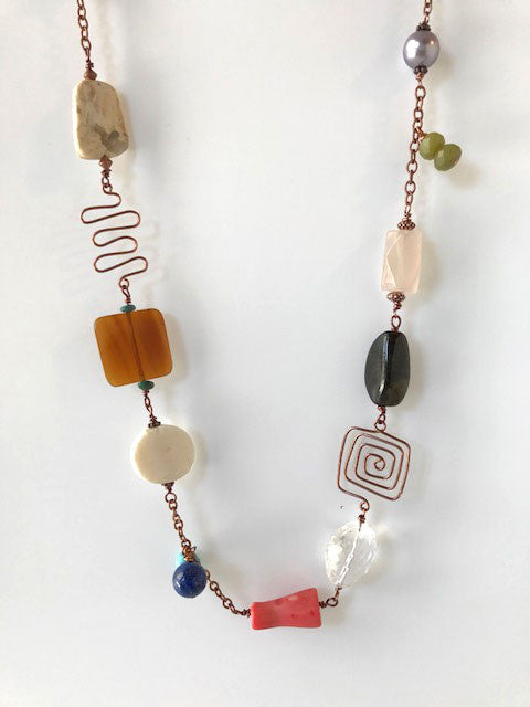 Multi gemstone beads with copper wire shapes necklace