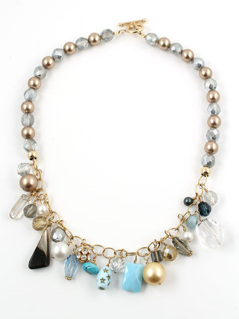 Shades of light blue charm necklace