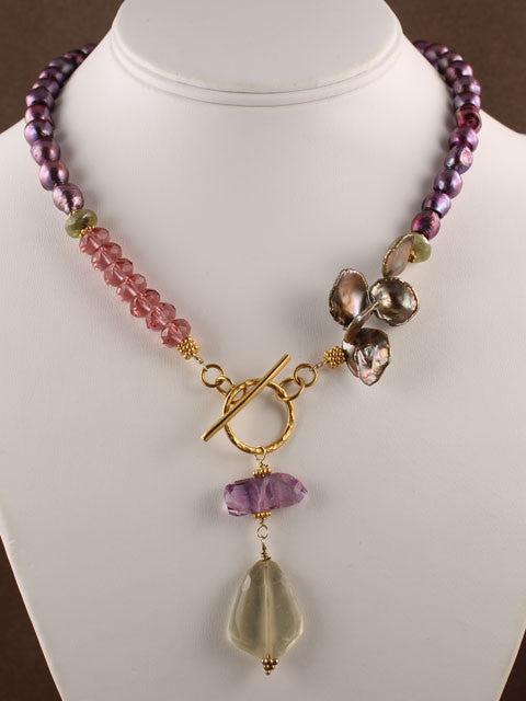 Purple and green gemstone and crystal necklace
