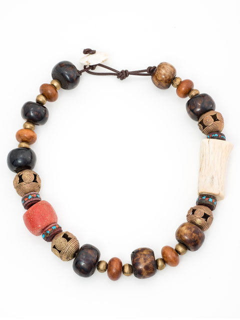 Brown bone, brass, coral and horn necklace