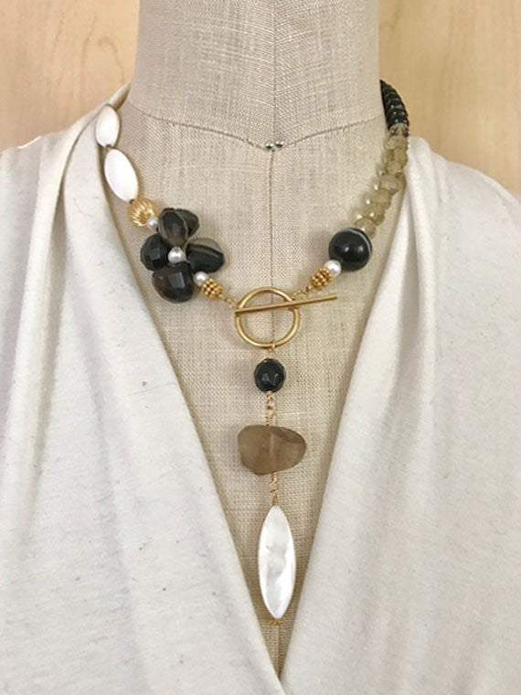 Brown, black and white pendant necklace