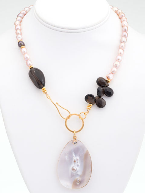 Pink pearl and smoky quartz front hook necklace