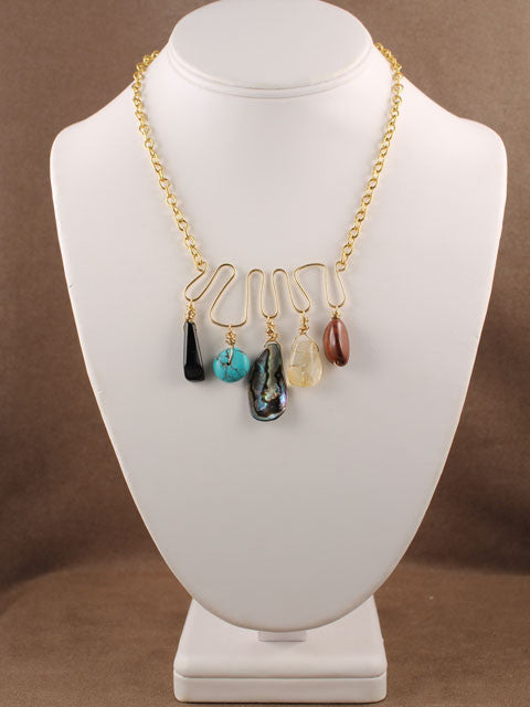 Gemstone beads on a wire shape necklace