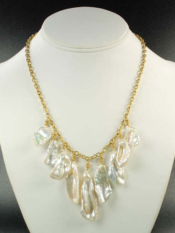 White pearl flakes on a chain necklace