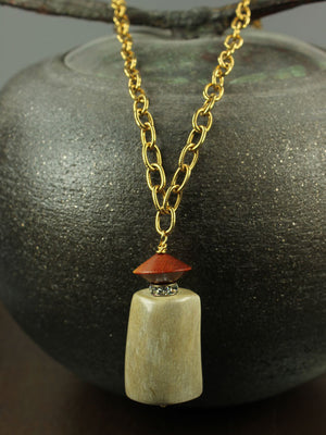 Horn, wood and crystal pendant necklace