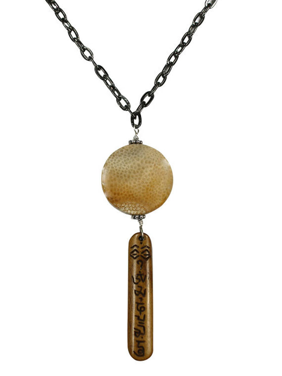 Carved bone pendant on black chain necklace