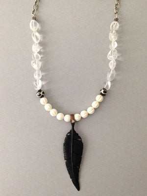 Black bone leaf pendant necklace