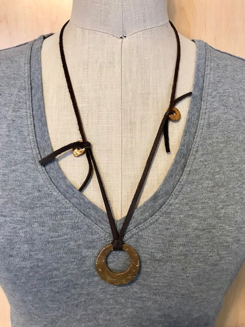Bronze charms on deerskin necklace