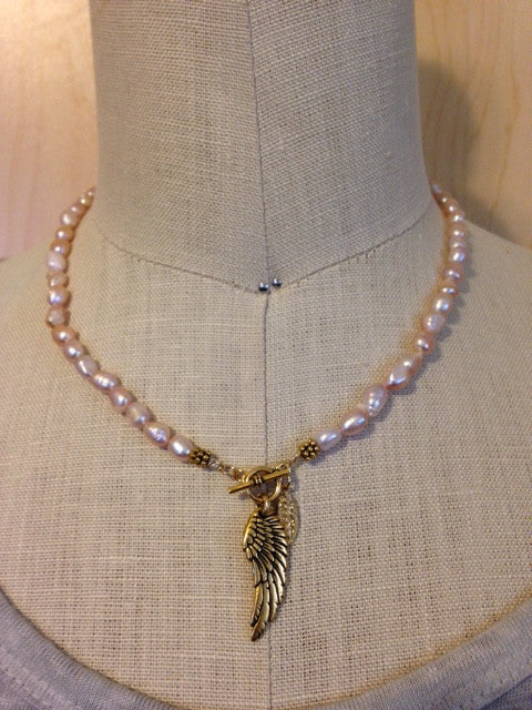Pink pearl and wing charm necklace