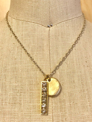 Rhinestone and disk charm necklace
