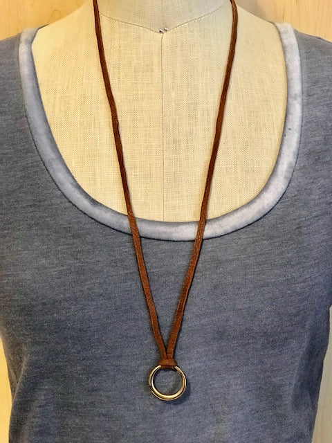 Deerskin with yellow bronze circle pendant