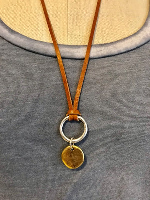 Deerskin with ring and pendant