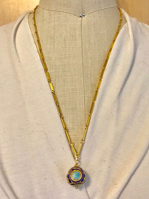 Blue and gold enamel ball on a chain necklace