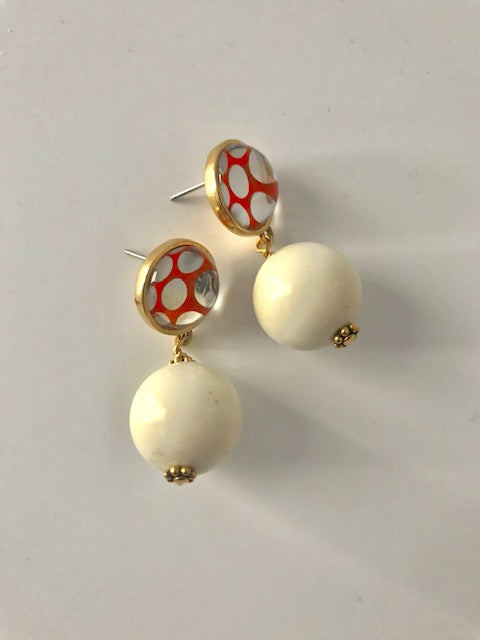 Orange dotted white lucite earrings