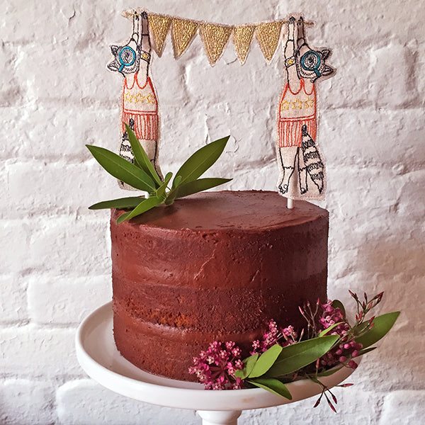 Coral and Tusk Raccoon Cake Topper