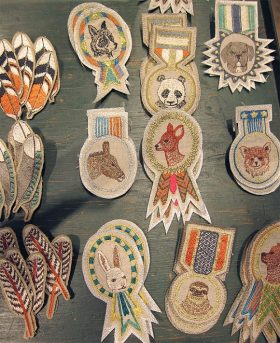 Kuhl Linscomb Coral & Tusk Merit Badges