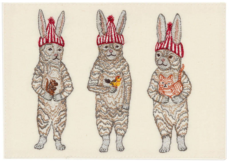 Embroidered Card depicting 3 bunnies wearing red striped beanies holding a chipmunk, bird, and cat.