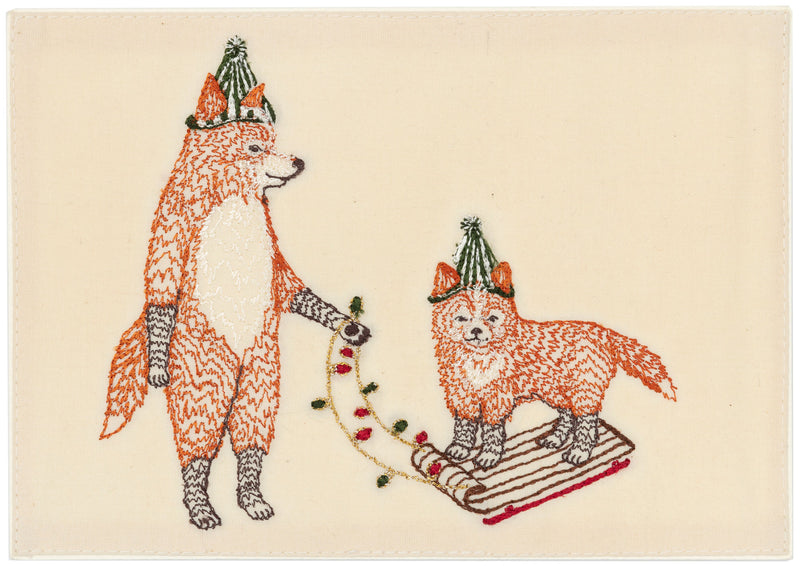Embroidered Card depicting Fox and baby fox on sled.