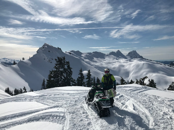 mountaintop view of snowmobiling in washington state