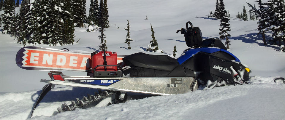 Snowboards, Skis, Gas Can - a secure way to carry it all on your sled.