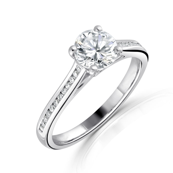 Brilliant Cut Diamond Solitaire with Channel set Diamond shoulders in Platinum