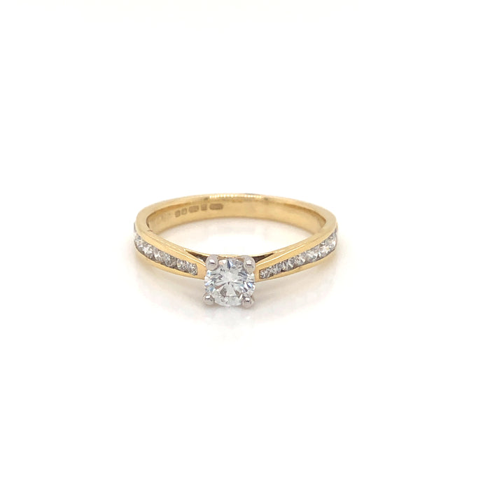 Diamond solitaire with diamond set shoulders in 18ct yellow gold