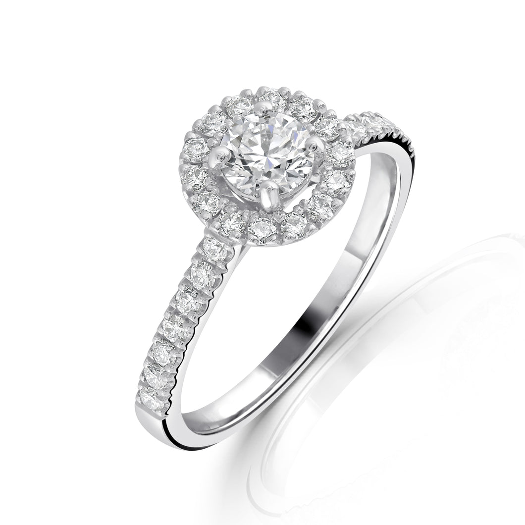 Halo Brilliant cut Diamond Solitaire with Diamond set shoulders in Platinum