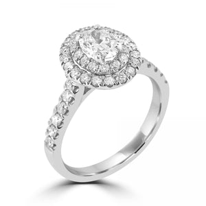 Double halo oval cut diamond with diamond set shoulders in Platinum.