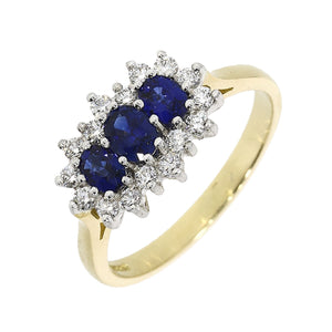 18ct Yellow Gold Oval Sapphire  and Brilliant Cut Diamond Cluster Ring