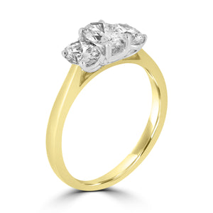 Graduated Trilogy of Oval diamonds on plain 18ct yellow gold band.